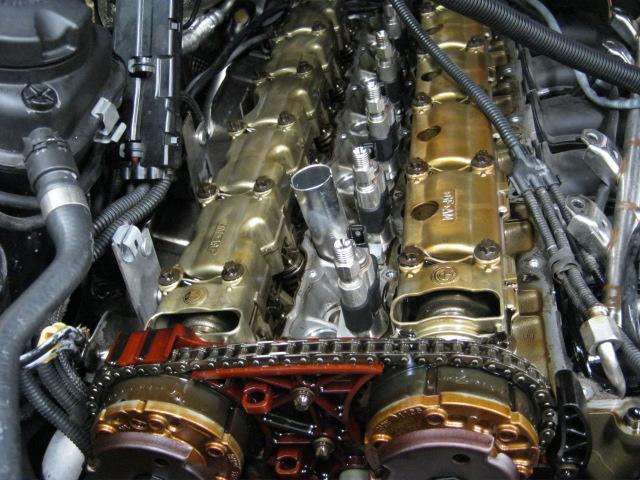 e90 head gasket oil leak